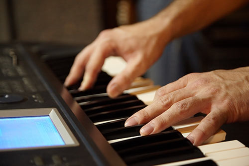 Rock pianist playing on a keyboard