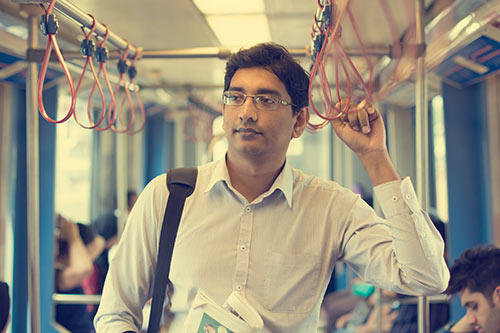 Man commuting in India