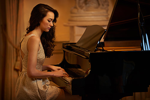 Lady practicing piano